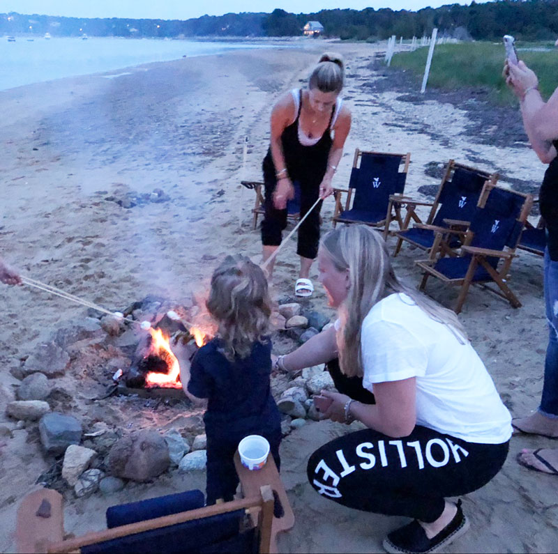 Au pair and host kid grilling marshmallow